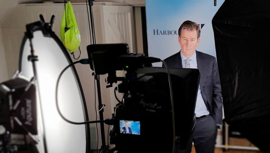 Businessman being filmed