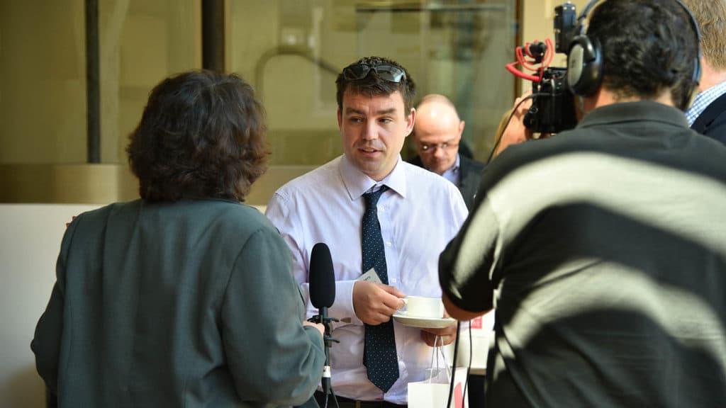 Businessmen being interviewed on video